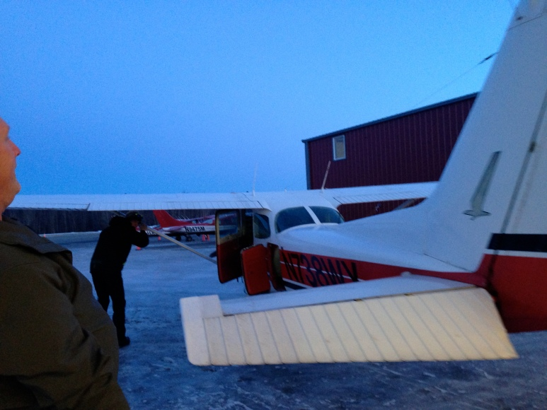 Getting the 4-seater bush plane ready for our trip from Aniak to Sleetmute.