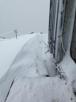 Snow drifts outside the wax conex